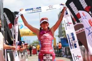 Sarah Haskins is shown crossing the finish line as she places first among women during the IRONMAN 70.3 Pan American Pro Championship in Panama. Photo: Copyright Kortuem Inc. 2016
