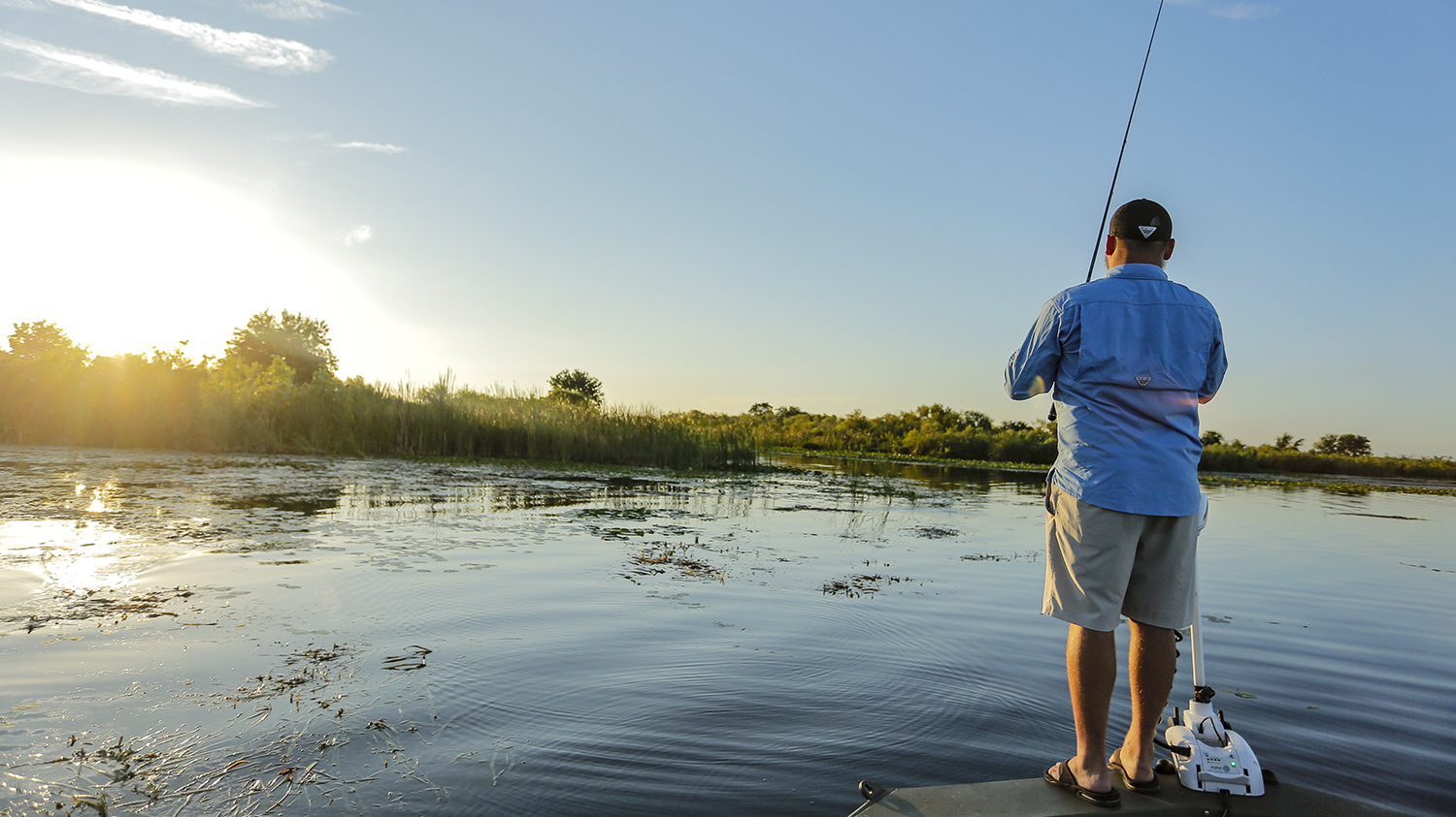 man fishing on bow of bass boat