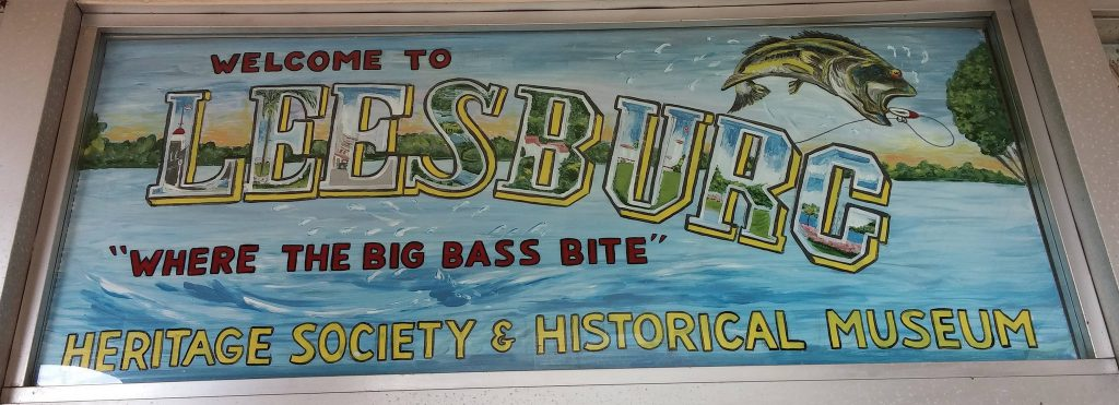 "Welcome to Leesburg Sign; ""Where the big bass bite."""