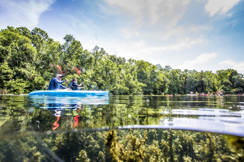 Father and son in a kayak on Alexander Springs
