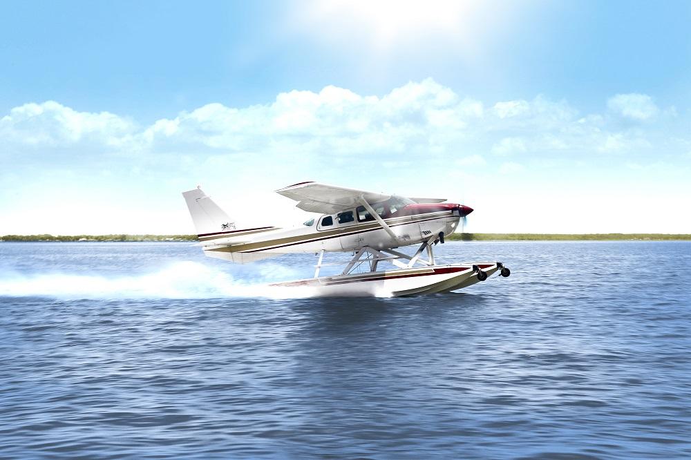 Seaplane taking off on lake