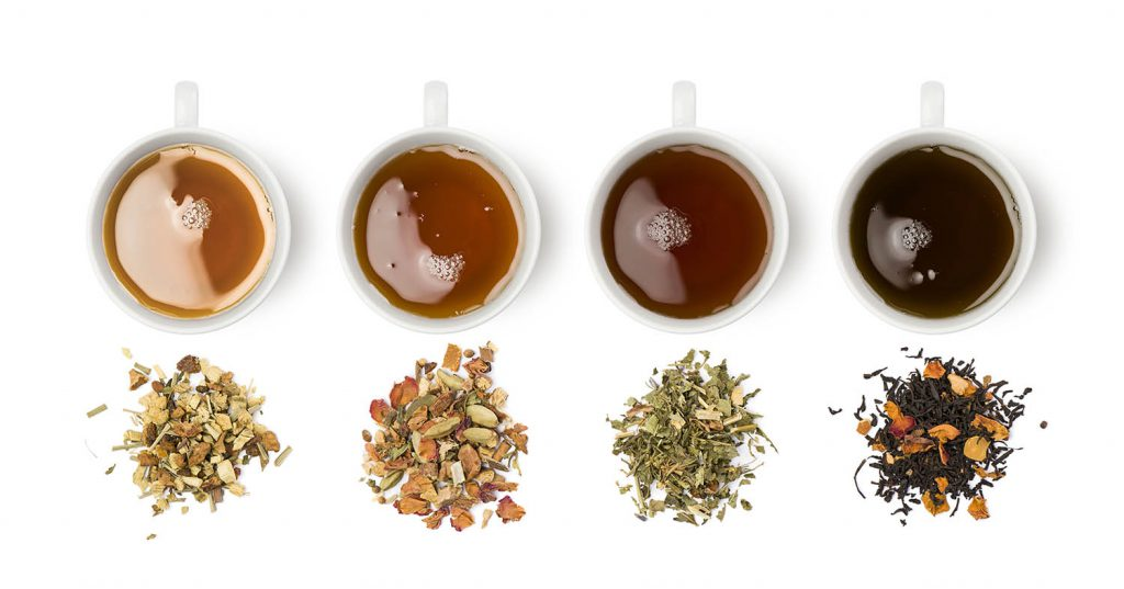 Various Cups of tea pictured with loose leaf tea and the brewed outcome.