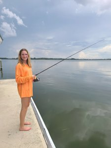 The blogger's daughter fishes from the pier.