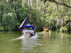 Two catboats navigate through the Dora Canal.