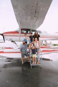 Family photo beside a seaplane in Tavares, Florida.