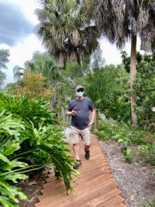 A man walks through Discovery Gardens.