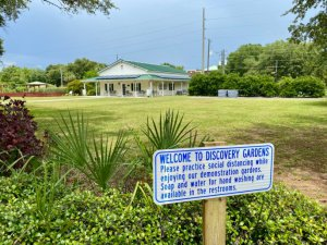 A welcome sign sits in front of Discovery Gardens.