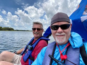 Jerry and Howard navigate Lake Dora in the cat boat.