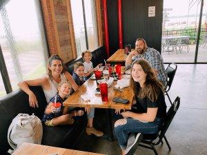 A family enjoys a meal at a restaurant.