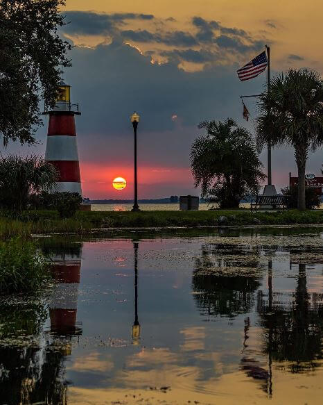 Photo of the Mount Dora lighthouse at Grantham Point park at sunset.