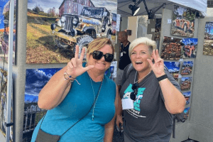Two women smile to the camera at the Leesburg Arts Festival.