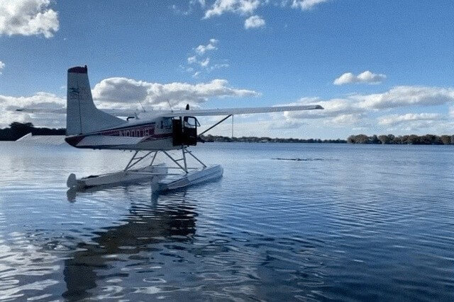 A seaplane sits on Lake Dora.