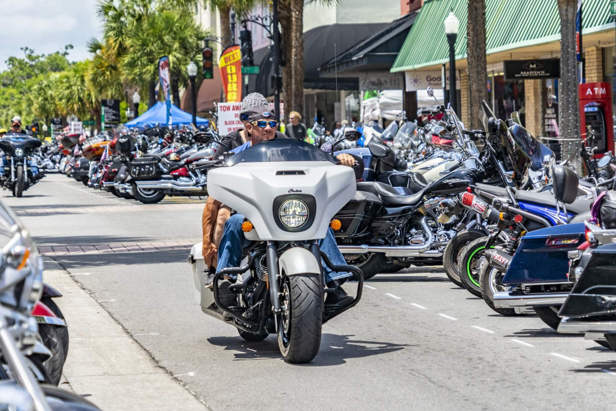 Bikefest 2019. Bikers drive down a street in Leesburg that is lined with hundreds of bikes.