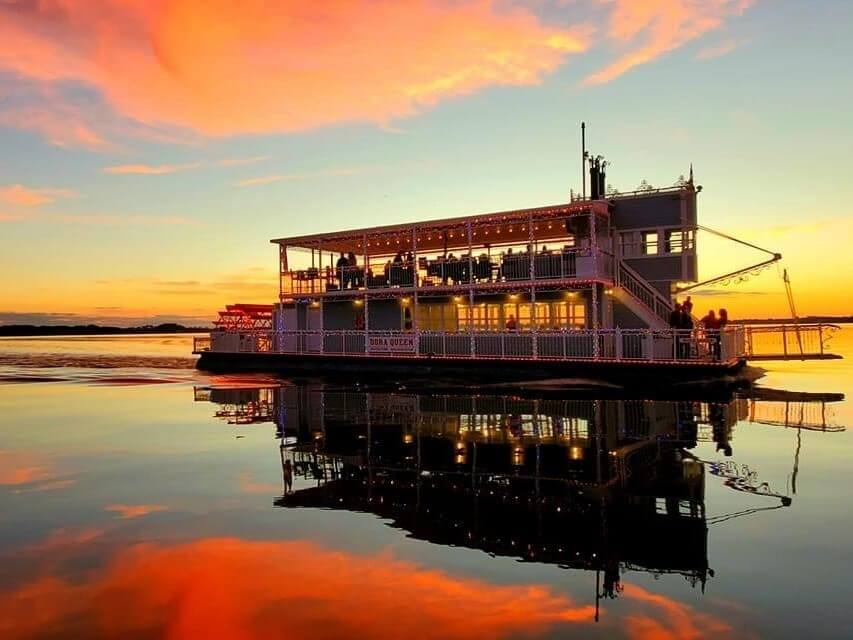 The Dora Queen paddlewheel boat sails across Lake Dora.