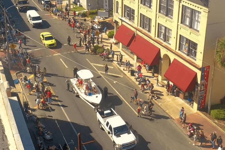 A parade takes place in Eustis during Georgefest 2021.