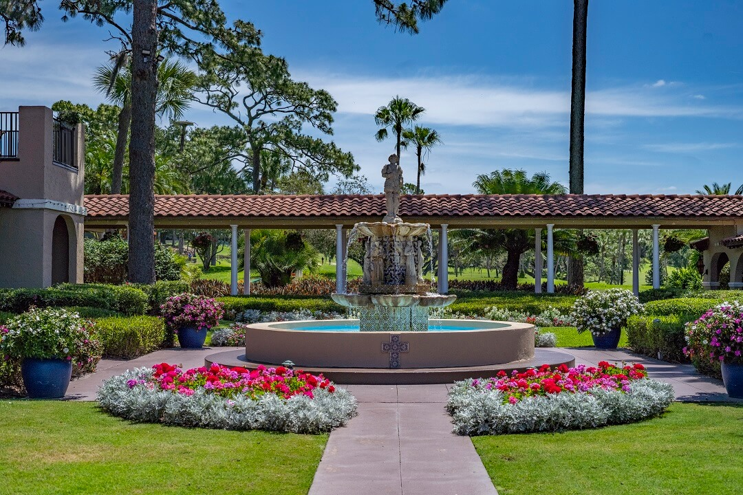 Photo of the large outdoor fountain and small surrounding garden at Mission Inn Resort & Club.