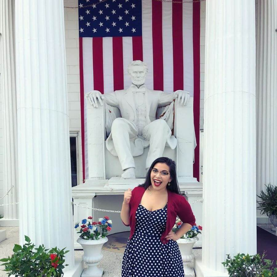 A woman stands in front of the Abraham Lincoln statue at the Presidents Hall of Fame in Clermont, FL.