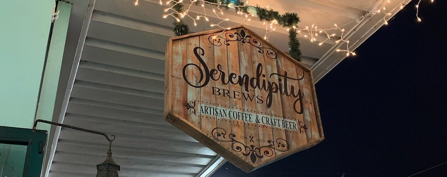 Photo of outdoor sign at Serendipity Brews.