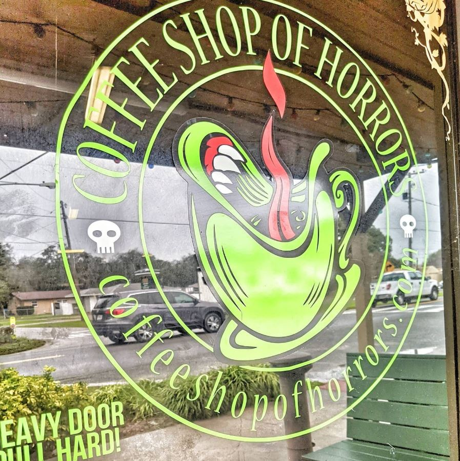 Photo of door sign at Coffee Shop of Horrors in Montverde.