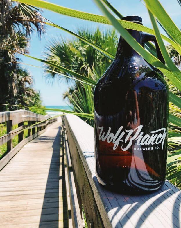Wolf Branch Brewing beer bottle photo on a boardwalk.
